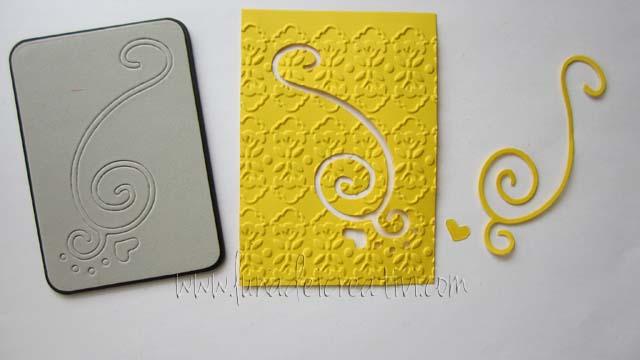 Cartoncino tagliato e embossato con Sizzlitz e Textured Impressions