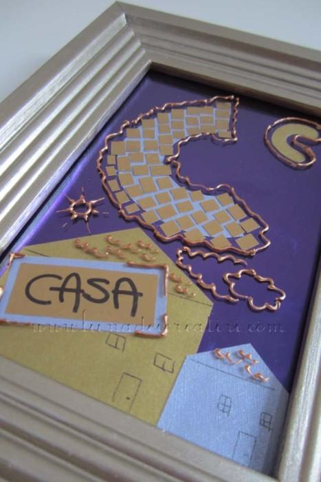 3. Con i ritagli di carta color oro e argento creiamo un quadretto