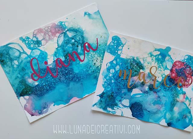 Ecco le scritte finite su sfondo Bubble Painting!